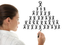 Pyramid scheme - business woman drawing royalty free stock images