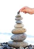 Pyramid of sea pebbles Stock Photos