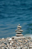 Pyramid from sea stones. Background with pyramid from sea stones Stock Image