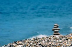 Pyramid from sea stones. Abstract background with pyramid from sea stones stock photos