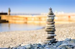 Pyramid of sea stones on pebbles of the sea shore. The concept of balance and spirituality. Stock Photography
