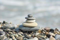 A pyramid of sea stones Stock Photos