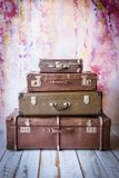 Pyramid of several vintage suitcases. On a pink background toned picture close-up shallow depth of field Royalty Free Stock Images