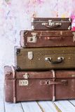 Vintage suitcases. Pyramid of several vintage suitcases on a pink background toned picture close-up shallow depth of field Stock Image