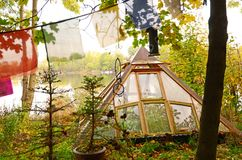A pyramid-shaped greenhouse with a lake in the background in the district of Christiania, Copenhagen, Denmark Stock Photography