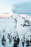 Pyramid Shaped Mountain Peak Covered in Snow Stock Photos