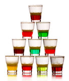 Pyramid of short colored alcohol cocktails isolated on white Royalty Free Stock Photo