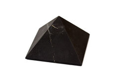A pyramid of shungite isolated on white background. Stock Photography