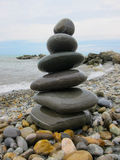 The pyramid of six  stones on the beach Royalty Free Stock Photography