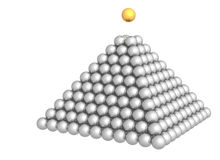 Pyramid of spheres with gold sphere on the top Royalty Free Stock Image