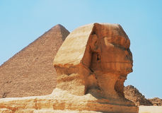 Pyramid and Sphinx. Head of the Sphinx in front of Giza Pyramid Stock Photography