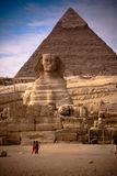 Pyramid and sphinx. Front shot of the sphinx and pyramid in plan of Giza, Egypt Stock Photo