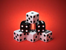 Pyramid Stacked Playing Dice on Red Background. Pyramid Stacked Playing Dice on Red Gradient Background Royalty Free Stock Image