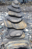 Pyramid of stacked stones at the beach Stock Photography
