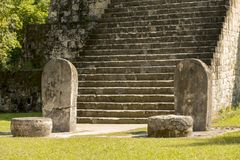 Complex Q Tikal Ruins Guatemala. Pyramid and stele in the Complex Q area of the Mayan ruins at Tikal, Guatemala royalty free stock images