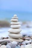 Pyramid of stones. On Cyprus beach stock photo