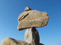 Pyramid from stones. Cairn (pyramid from stones) on blue sky background Royalty Free Stock Image