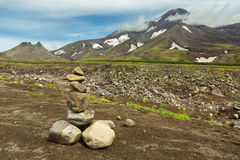 Pyramid of stones on a background of Avacha Volcano or Avachinskaya Sopka on Kamchatka Peninsula Stock Photography