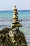 Pyramid of stones on a background of beautiful sea landscape Royalty Free Stock Photography