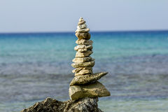 Pyramid of stones on a background of beautiful sea landscape Royalty Free Stock Photo
