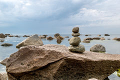Pyramid of stones on a background of beautiful sea landscape Royalty Free Stock Images