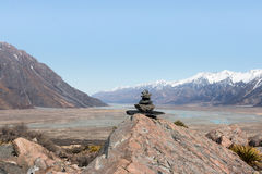 Pyramid of stones on background of mountain and valley Stock Image