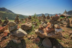Pyramid of stones on a background of mountains Stock Photography