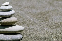 Pyramid from stones on the beach stock image