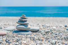 Pyramid of stones on the beach stock photo
