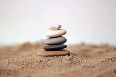 Pyramid of stones. On the beach royalty free stock photo