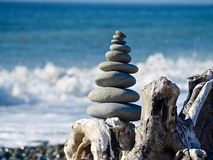 A Pyramid of Stones on the Beach Stock Images