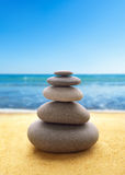 Pyramid of the stones on beach Stock Photography