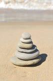 Pyramid of stones on the beach, zen balance. Balancing stones placed on the beach stock photo