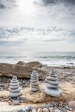 Pyramid of stones. Cairn, Pyramid of stones on the sea Royalty Free Stock Photography