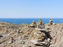 Pyramid of stones on Cap de Creus, Spain Royalty Free Stock Photos