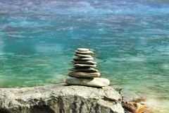 Pyramid from the stones. Laid out on a beach stock photography