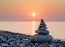 Pyramid of stones on sea coast Stock Photo