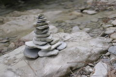 Pyramid of stones. On the mountain river Stock Photography