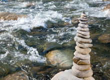 Pyramid of stones. Beside a mountain river Stock Photo