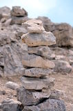 Pyramid of stones on the mountainside Royalty Free Stock Photography