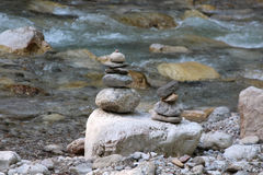 A pyramid of stones. Near the mountain river Stock Photography