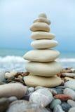 Pyramid of Stones near Sea on Beach Royalty Free Stock Images