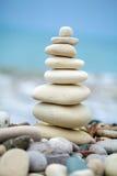 Pyramid of Stones near Sea on Beach Stock Image