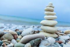 Pyramid of Stones near Sea on Beach Stock Photography