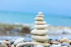 Pyramid of Stones near Sea on Beach Stock Images