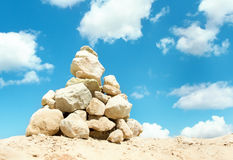 Pyramid of stones over blue sky Stock Photo
