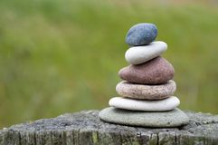 Pyramid of stones with pebbles from the beach. Pyramid of stones and pebbles from the beach, meditation and balance stock photography