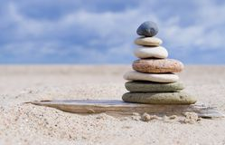 Pyramid of stones with pebbles from the beach. Pyramid of stones and pebbles from the beach, meditation and balance stock photo