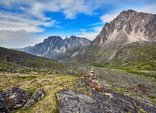 Pyramid of stones - a pointer to the path in the mountain tundra Royalty Free Stock Photos