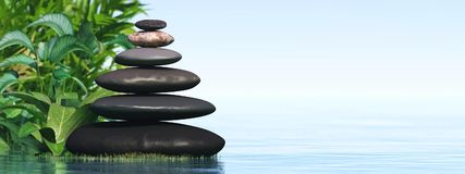 A pyramid of stones. Above the water. Massage parlor. Spa business stock images